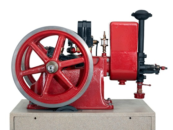 Colour photograph of a horizontal single cylinder petrol engine designed to power farm equipment and workshop tools