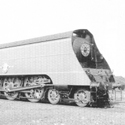 Black and white photograph of a streamlined steam train from 1942
