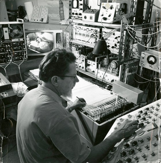 Black and white photograph of William Grey Walter and a 16 channel EEG
