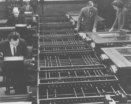 Black and white photograph of a number of people working on a differential analyser machine