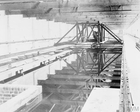 Black and white photograph of a railway mounted gantry spanning a boat testing tank