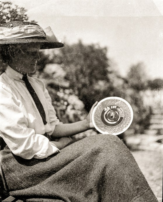 Black and white photograph of Blanche Thornycroft holding a disc used for recording test data