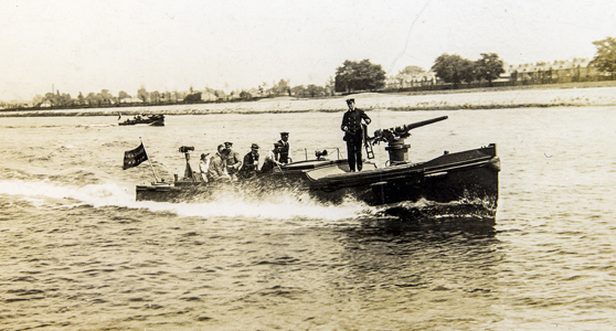 Black and white photograph of a pre first world war boat travelling on the Thames river
