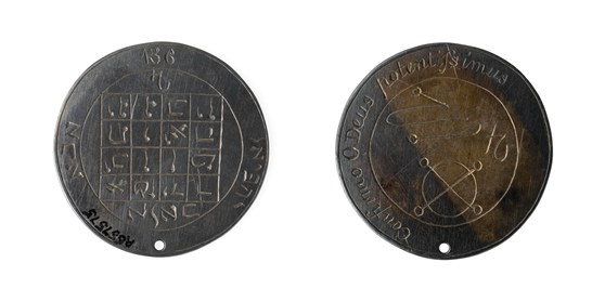 Colour photograph of the front and reverse sides of a coin amulet