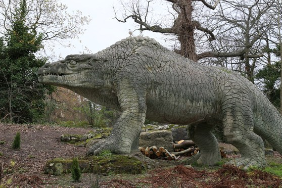 Colour photograph of a concrete megalosaur model from the nineteenth century