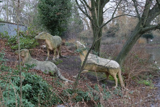 Colour photograph of three concrete anoplotherium models from the nineteenth century