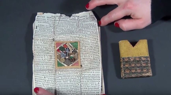 Still from a video showing how to open a breverl amulet