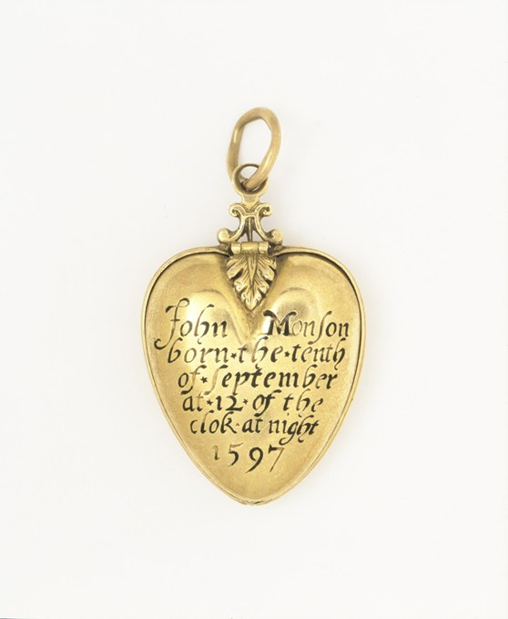 Colour photograph of an engraved heart shaped gold pendant