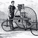 Engraving of a Coventry Rotary Tricycle with bellows camera fixed to the lateral bar from the late nineteenth century