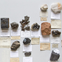 Colour photograph of a number of mineral samples of rock types that are used in modern consumer technologies