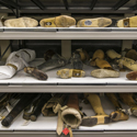 Colour photograph of prosthetic limbs in shelving storage