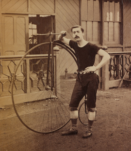 Cyclist with high wheeler bicycle in the late nineteenth century