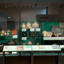 Colour photograph of historical cookery and dining items on display in an exhibition gallery