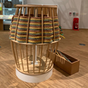 Colour photograph of a basket making themed interactive display in an exhibition gallery