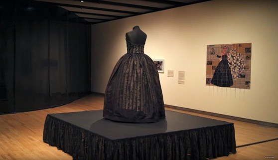 Video still showing a black memorial dress on display in the Southbank Centre London
