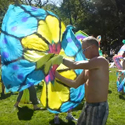 Video still of memorialisers flag twirling in a park in San Francisco