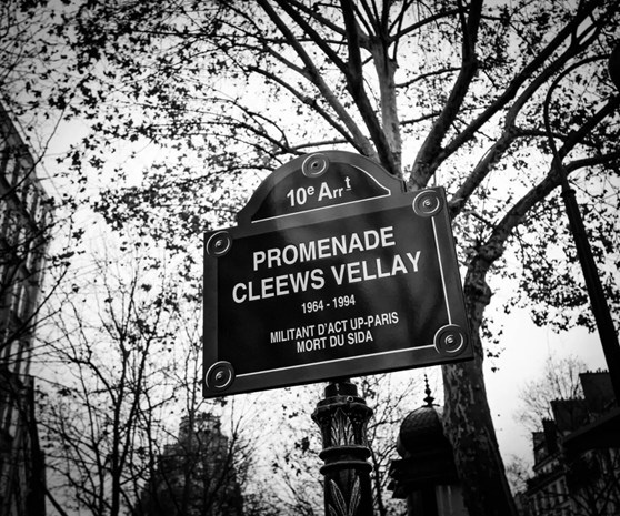 Black and white photograph of the street sign for Promenade Cleews Vellay